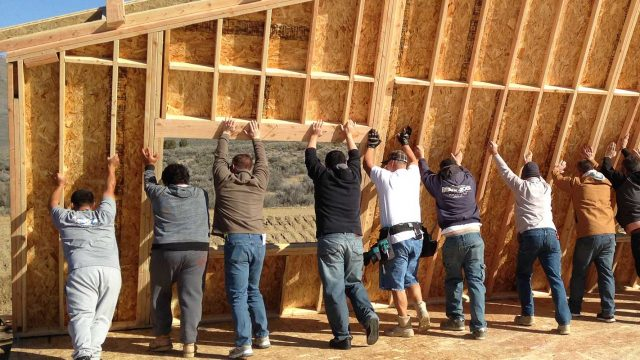 Reno home builders from the Lifestyle Homes holding up side of home to be built